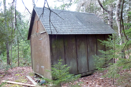 Mike Bracy's fish shack, moved from the shore to the woods.