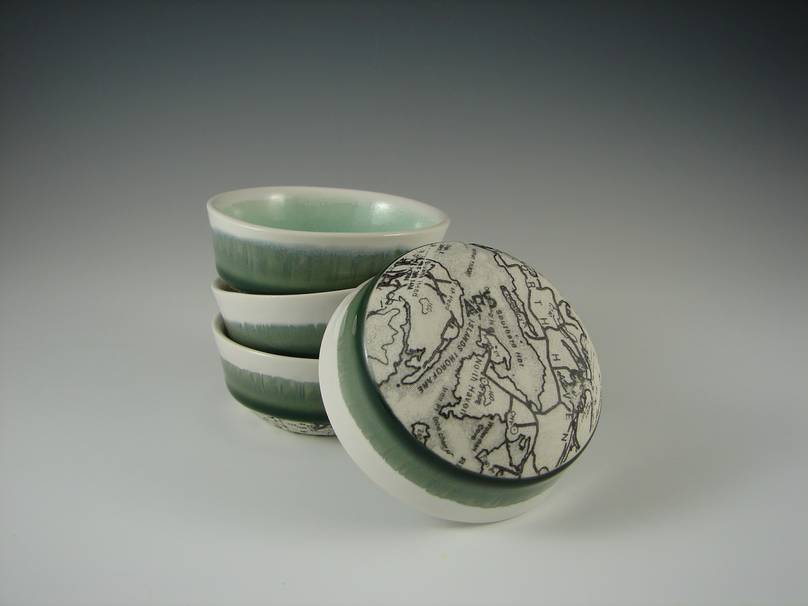 Salt Cellars with chart wrapped bottom, porcelain and decals, H. 1.5'', 2013.