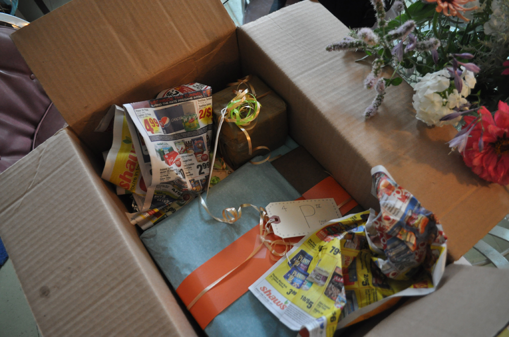 Stuffing a box with old sales flyers.