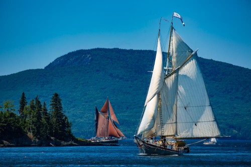 The schooner Lewis R. French, right, and Angelique, center, pass Mark Island in the middle of Penobscot Bay.